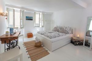 Ein Bett oder Betten in einem Zimmer der Unterkunft Getreidegassen Appartements