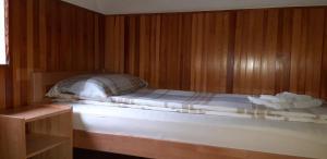 Postelja oz. postelje v sobi nastanitve Holiday House TOLLAZZI