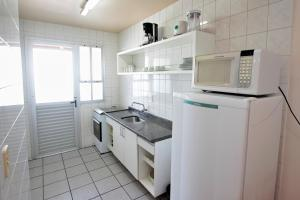 A kitchen or kitchenette at Belluno Apart Hotel