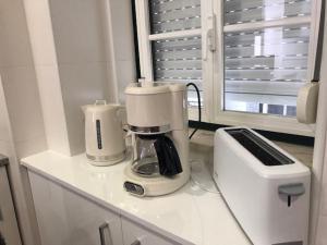 A kitchen or kitchenette at FADO Bairro Alto - SSs Apartments