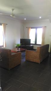 A television and/or entertainment centre at Secret Garden Villa 4