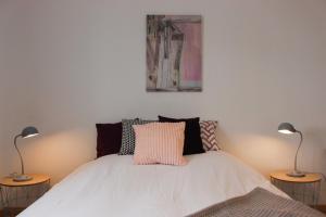 Ein Bett oder Betten in einem Zimmer der Unterkunft HAPPY MAMA COLMAR