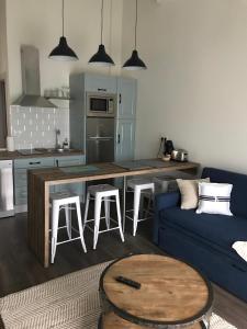 Una cocina o zona de cocina en Apartamentos Estela de Altamira