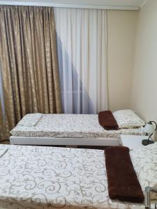 A bed or beds in a room at Vilotic group,Apartman 2