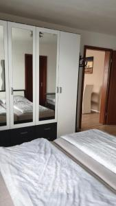 A bed or beds in a room at Ferienwohnung Schwarzwald