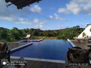 The swimming pool at or near Villa Nobre Diniglei