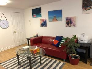 A seating area at Luxury Private Apartment with Herbal and Organic theme, Free Parking and Light Breakfast, on Montreal island near downtown, direct 24/7 public transit direct to Downtown