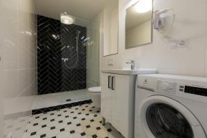 Koupelna v ubytování Avantgarde apartments