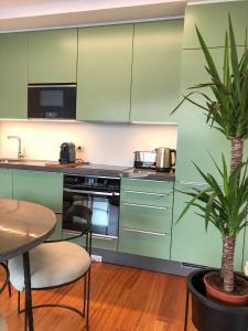 A kitchen or kitchenette at Oporto Chic&Cozy - Aliados