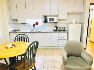 Una cocina o kitchenette en Regency Bombal Apartments