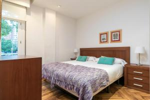 A bed or beds in a room at Volantin by Forever Rentals