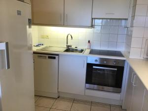 A kitchen or kitchenette at Apartment Residentie 21