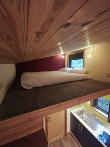 A bed or beds in a room at Tiny House-Hot Tub-St Clears-Pembrokeshire-Tenby
