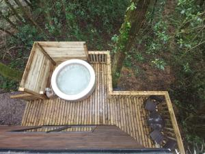 A balcony or terrace at Tiny House-Hot Tub-St Clears-Pembrokeshire-Tenby