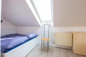 A bed or beds in a room at Schmuckstück In Münster