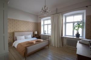 Gulta vai gultas numurā naktsmītnē Old town Library apartment, Tartu Holidays