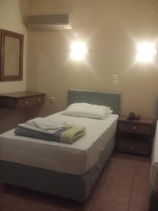 Ένα ή περισσότερα κρεβάτια σε δωμάτιο στο G. Kiapekou