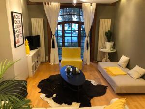 Coin salon dans l'établissement Apartment Easyway to sleep