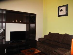 Una televisión o centro de entretenimiento en Apartment Casa de Mama - Pachacutec