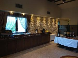 A kitchen or kitchenette at Arhontopetra Suites & Spa