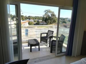 A balcony or terrace at Apartamento Vila Marachique