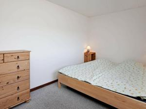 A bed or beds in a room at Three-Bedroom Holiday home in Bindslev 6