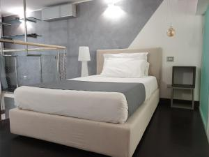 A bed or beds in a room at De Angeli Dream House
