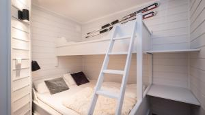 A bunk bed or bunk beds in a room at Ski, fish, golf, hiking in Hemsedal