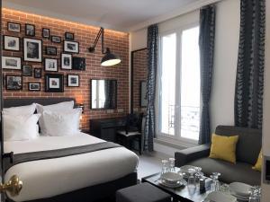 Ein Bett oder Betten in einem Zimmer der Unterkunft Résidence Voûte by Patios du Marais