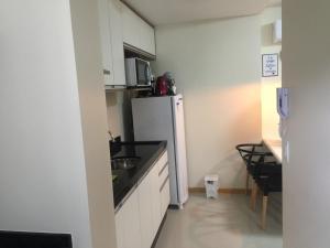 A kitchen or kitchenette at Residencial PIAGET (Torre Bruner)