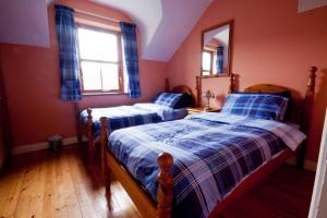 Un ou plusieurs lits dans un hébergement de l'établissement Achill Cottages