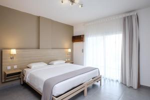 Кровать или кровати в номере Pandream Hotel Apartments