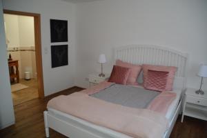 Postel nebo postele na pokoji v ubytování Im Maifeld