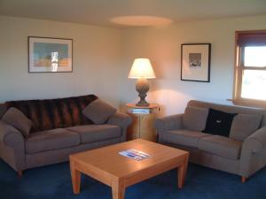 A seating area at Whitestone Cottages