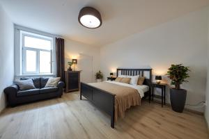 A bed or beds in a room at Le Monde Apartment Bratislava