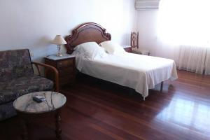 A bed or beds in a room at Apartamento Edif.Planeta 2º Centro