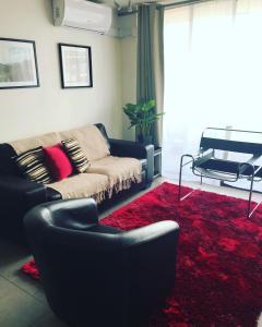 Zona de estar de In Out Apartments Las Condes