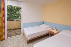 Cama ou camas em um quarto em Lanterna Sunny Resort by Valamar
