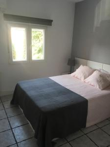 A bed or beds in a room at Europa Mugica