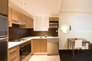 A kitchen or kitchenette at APX World Square