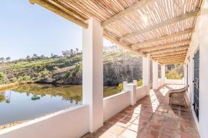 A balcony or terrace at Druk My Niet Wine Estate