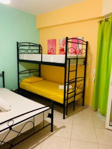 A bunk bed or bunk beds in a room at Schoinaria Bay