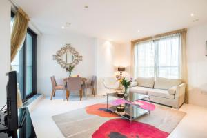 Et sittehjørne på Modern Apartment In Canary Wharf / O2 / Docklands by Boutique Apartments
