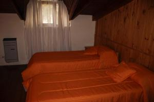Una cama o camas en una habitación de Bungalows KALENA Playa Bonita DAT