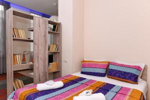 A bed or beds in a room at Bagratuniats Apartment