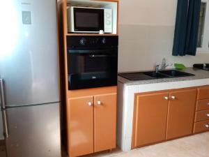 A kitchen or kitchenette at Résidence Karukéra