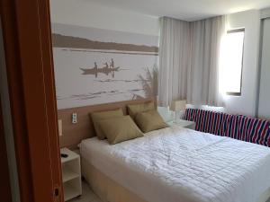 A bed or beds in a room at Residence Resort - Barra de São Miguel