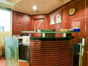 مطبخ أو مطبخ صغير في OYO 249 Oasis Hotel Apartment