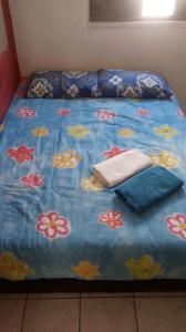 A bed or beds in a room at Apartamento Completo