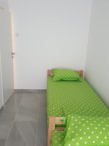 A bed or beds in a room at Apartman 1 ,Avalska 15 Gaj